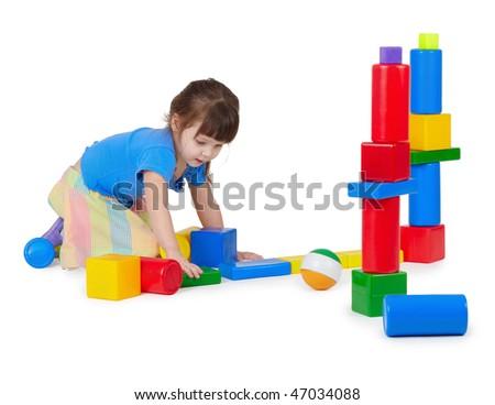Girl playing toy bricks - stock photo