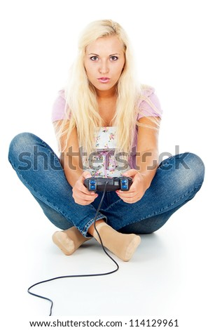 girl playing video games on the joystick - stock photo
