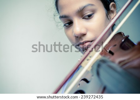 girl playing violin with writing space - stock photo