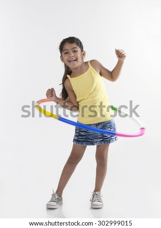 Girl playing with a hoola hoop - stock photo
