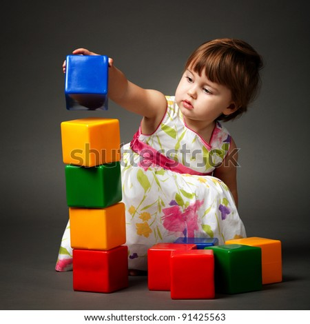girl playing with blocks - stock photo