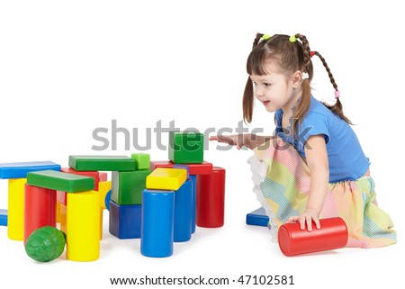 Girl playing with color toys on white background - stock photo