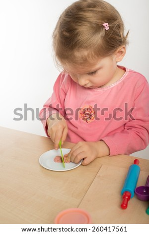 Girl  playing with colorful clay - stock photo