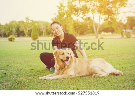 Girl playing with dog on grass green