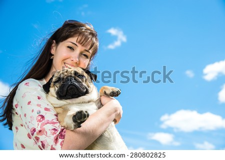 Girl playing with her dog on the nature - stock photo