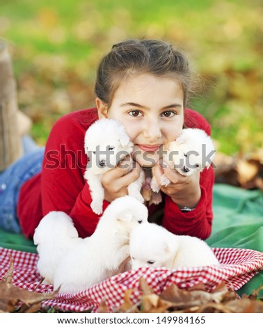 Girl Playing with her five puppies - stock photo