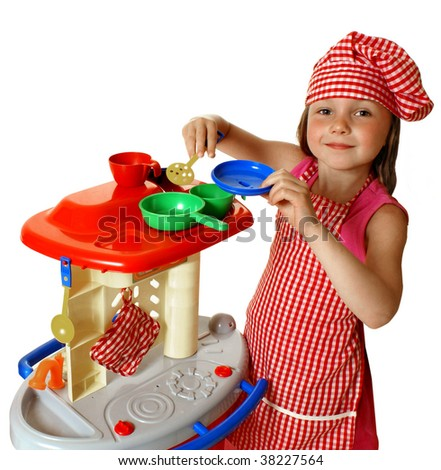 Girl playing with kitchen - stock photo