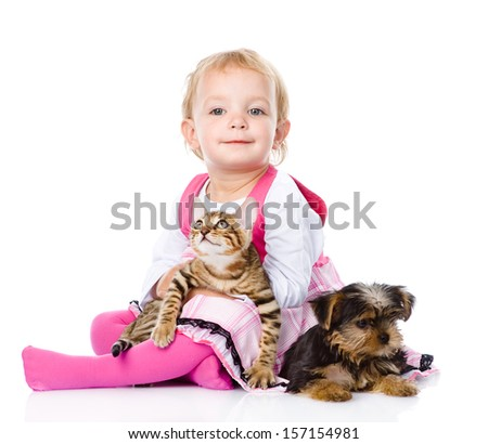 girl playing with pets - dog and cat. looking at camera. isolated on white background