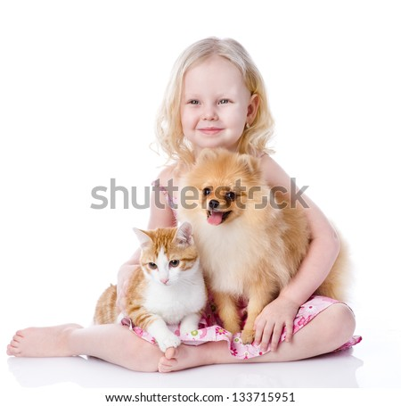 girl playing with pets - dog and cat. looking away. isolated on white background - stock photo