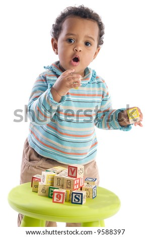 Girl playing with small pieces a over white background - stock photo