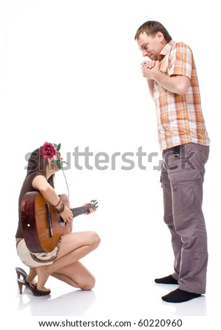 girl plays the guitar for a boy on a white background - stock photo