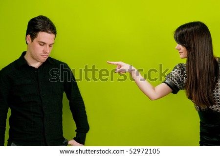 Girl pointing finger at man in accusing manner - stock photo