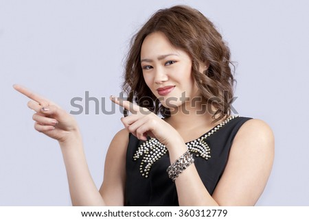Girl pointing gesture with two hands, a horizontal portrait - stock photo