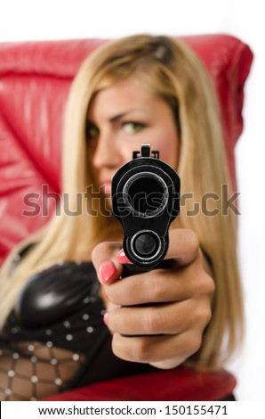 Girl pointing gun at camera - stock photo
