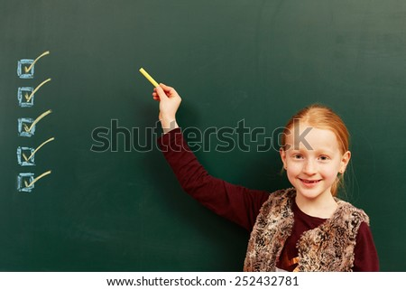 Girl points to the list on the board