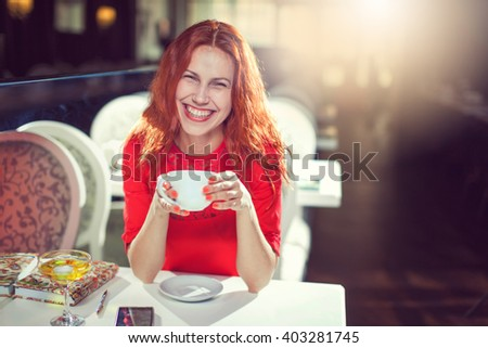 Girl portrait with cup of coffee - stock photo