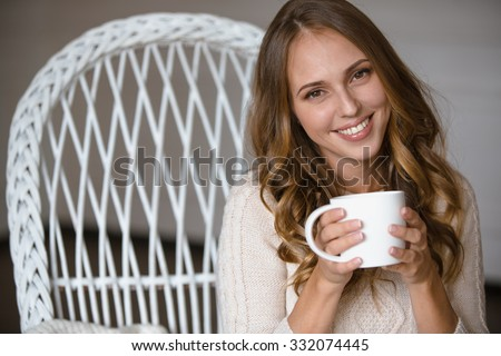 Girl portrait with cup of coffee at home - stock photo