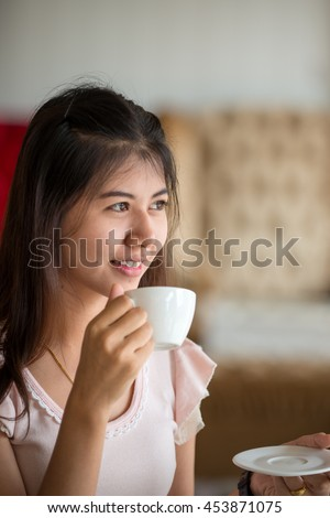 Girl portrait with cup of coffee at the cafe