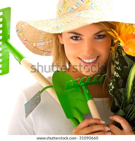 girl portrait with gardening tools - stock photo
