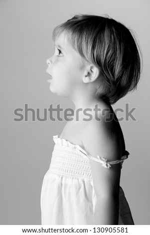 Girl portrayed in profile. - stock photo