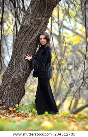 Girl posing against a tree in the park