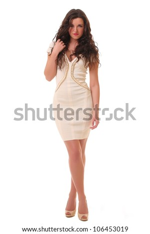 girl posing in a white dress isolated over white background - stock photo