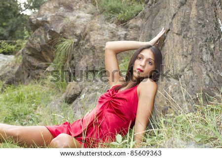 girl posing in red dress - stock photo