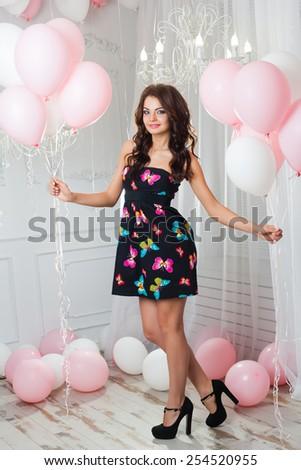 girl posing in the interior in dresses - stock photo