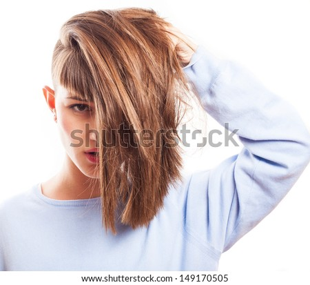 girl posing playing with her hair on a white background - stock photo