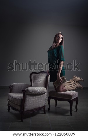 Girl posing with retro furniture - stock photo