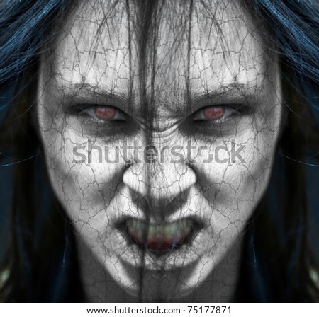 Girl possessed by the devil looks at you out of darkness - stock photo