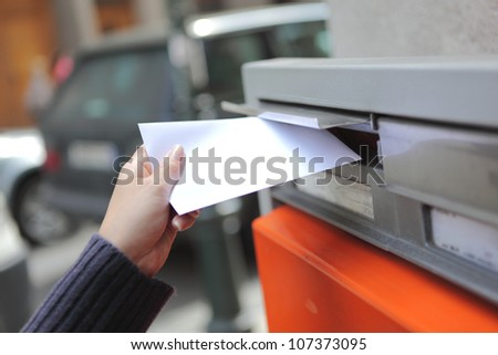 girl posting a letter in Czech Republic - stock photo