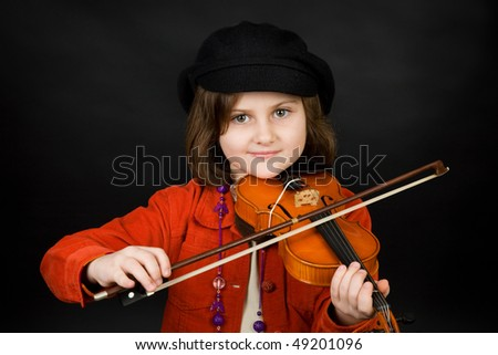Girl practicing the violin - stock photo