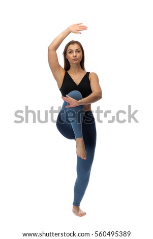 Girl practicing yoga in a studio on a white background. Isolated.