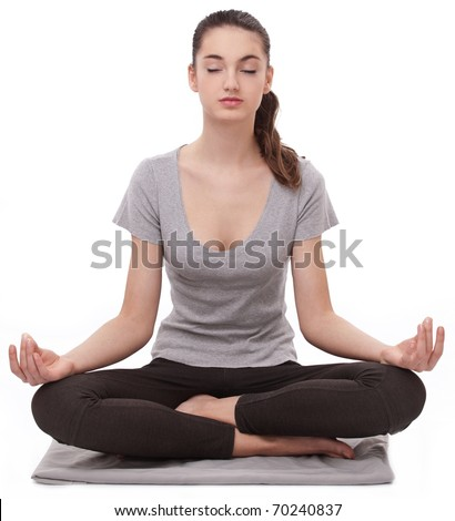 Girl practicing yoga. Isolated in a white background.