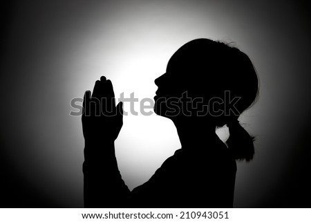 Girl prays to heaven. - stock photo
