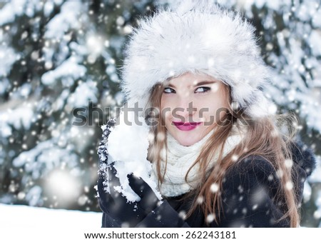 Girl preparing a snowball for a snowball fight. - stock photo