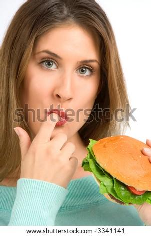 Girl preparing to eat fresh tasty burger - stock photo