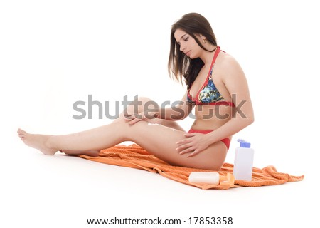 Girl preparing to take hours of sunbathing. Over white background