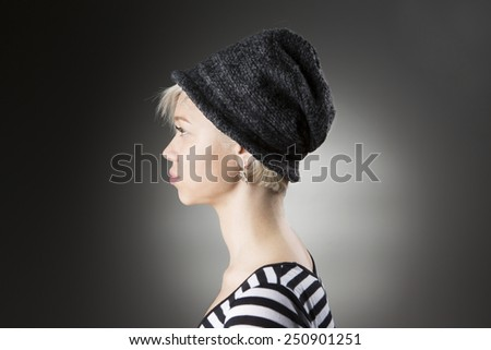 Girl profile in a stylish hat looking away - stock photo