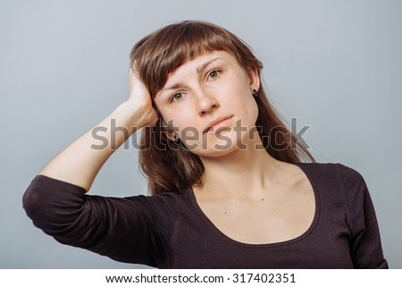 girl propped her head hand - stock photo