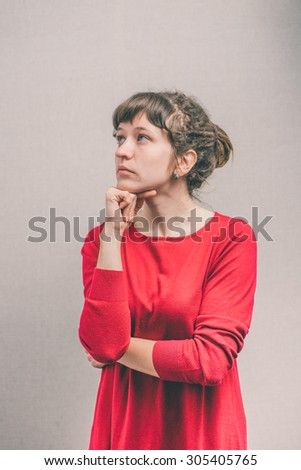 girl props his chin with his fist - stock photo