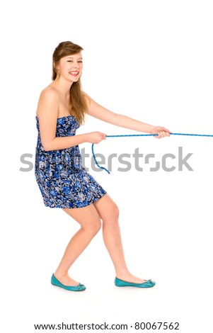 Girl pulling a rope - stock photo