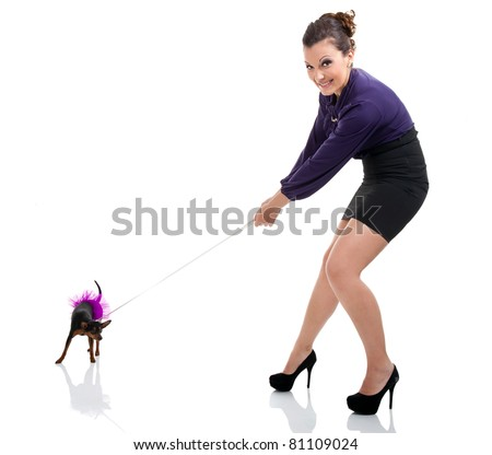 girl pulling miniature pincher  on leash, isolated on white background
