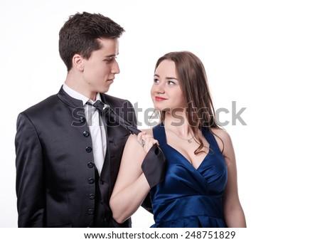 Girl pulls her boyfriend tie. Valentine Couple. Love Concept. Valentines Day - stock photo