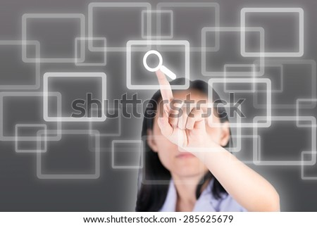Girl pushing magnifying glass  button with technology background