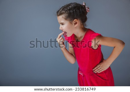 girl put a finger in his mouth disgusted - stock photo