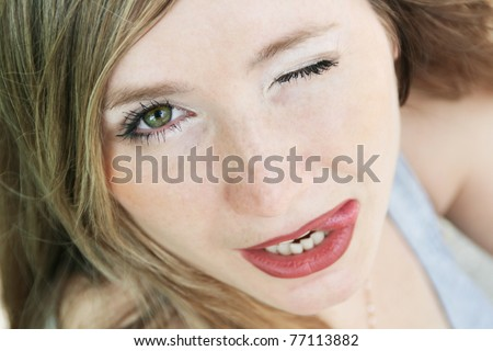 Girl put out tongue and wink - stock photo