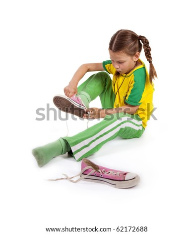 girl puts sport shoes on