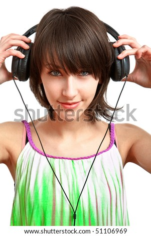 girl putting headphones on and looking to the camera - stock photo